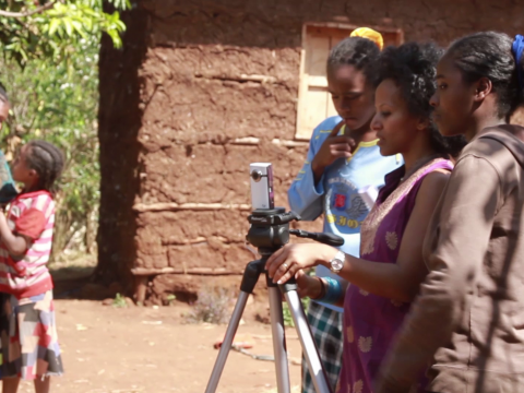 Bruktawit Tigabu instructing girls how to use a camera for Ethiopia's part in the Girls' Education Challenge